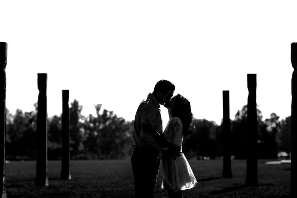 Black and white silhouette of couple kissing before their Laguna Beach engagement session