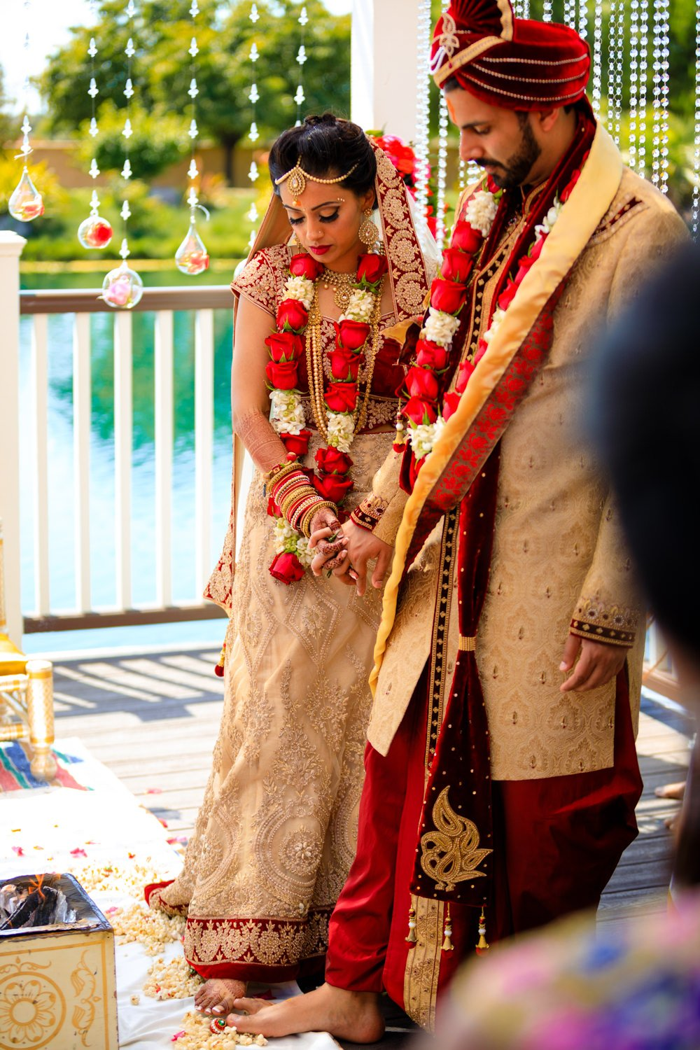 Indian bride and groom in the middle of a ceremony held at Newberry Estates in Brentwood in Northern California