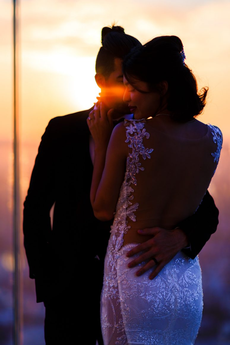 Bride and groom sunset portrait on the 69th floor of DTLA building at OUE Skyspace